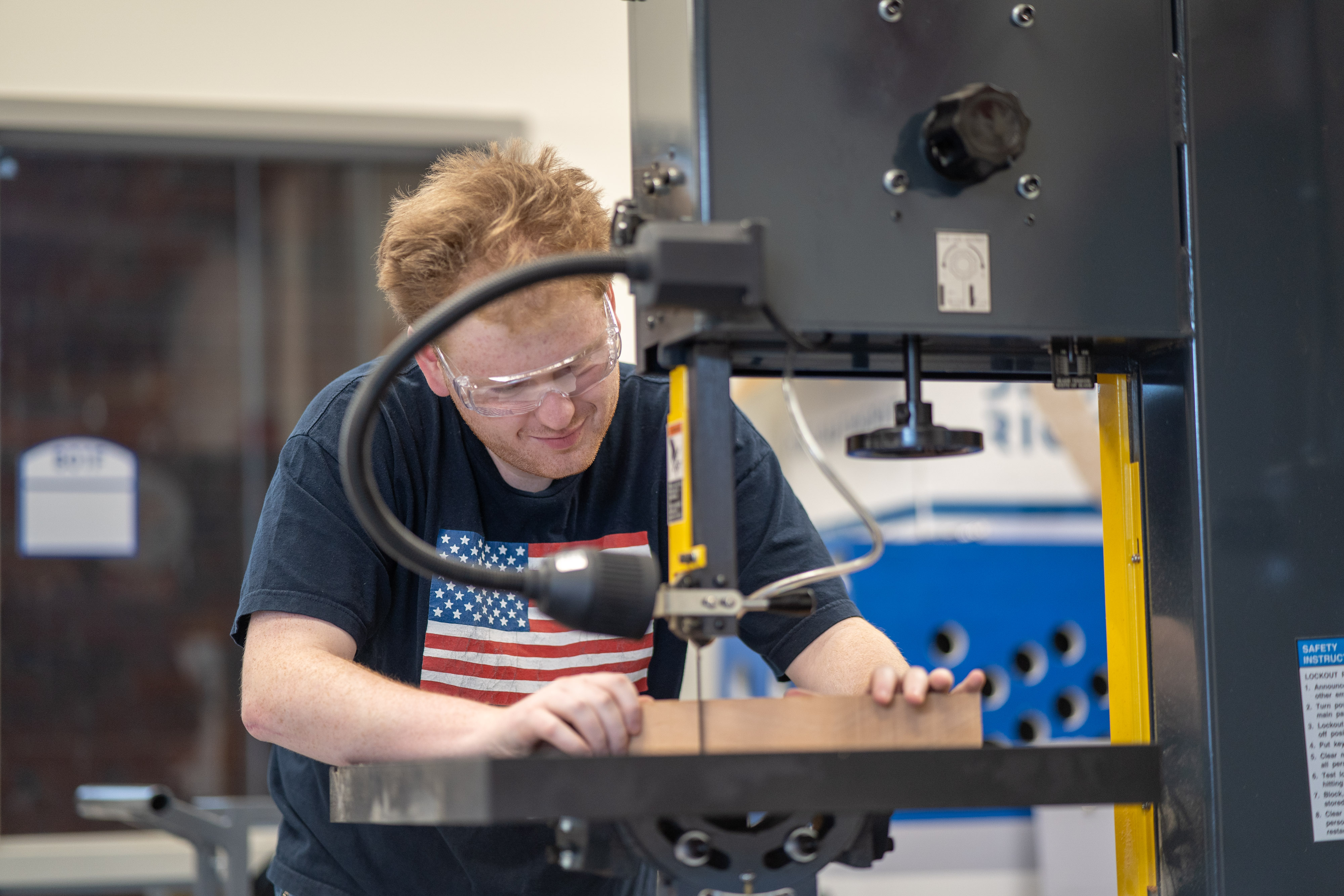 UNH Manchester student fabricates a guitar in the machine shop