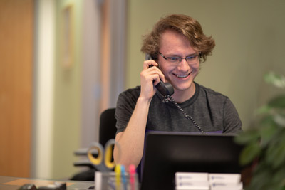 student smiling while on the phone