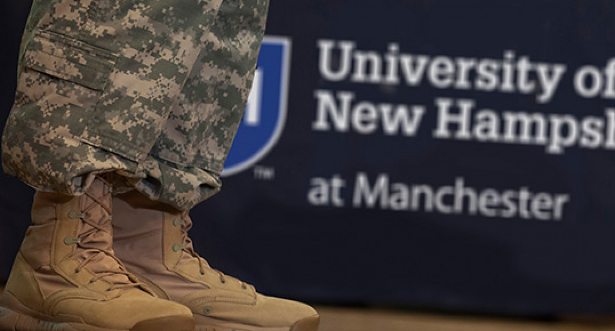Military camo legs and boots and UNHM sign