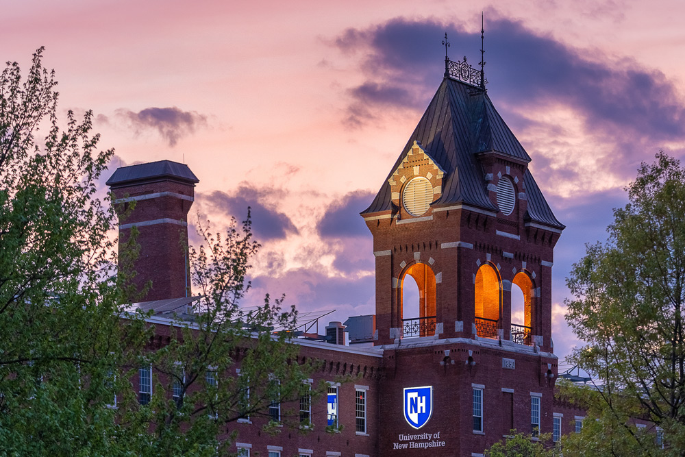 unh manchester campus at dusk