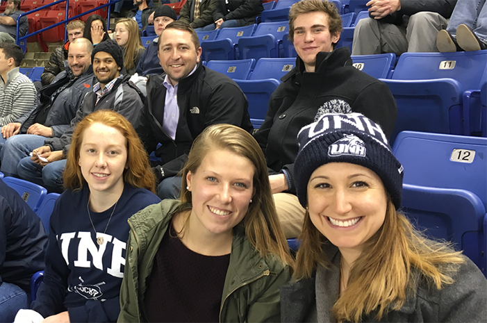 Girls sitting at a hockey game