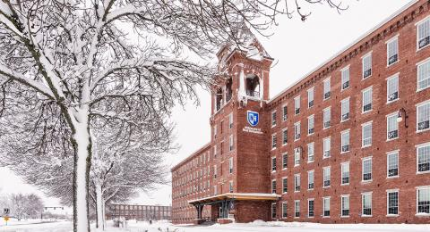 Snowy photo of UNH Manchester building