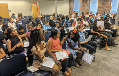 Students and families gathered for the Aug. 1 graduation ceremony at UNH Manchester.