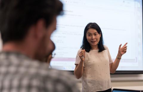 Woman teaching the class