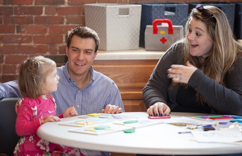 Nicholas Mian, assistant professor of psychology, and psychology student Jasmine Huffman '19, right, working on a study that measures emotions in young children.