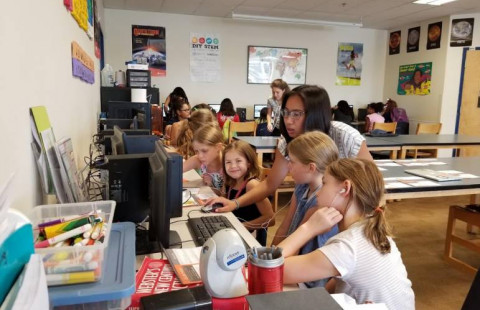 Past Aspirations in Computing Award recipient helps with a girls' coding program.