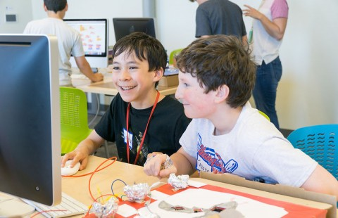 Kids work on robotics projects in the UNH STEM Discovery Lab