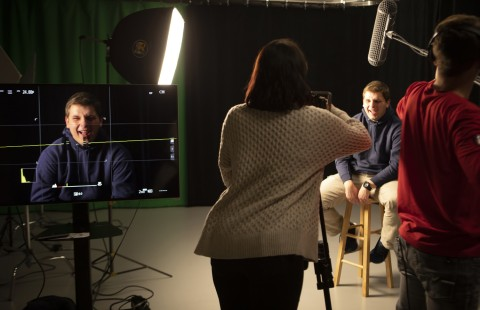 students filming in the communication arts film suite